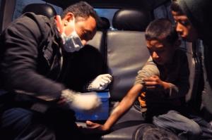 Saroj giving treatment to a boy