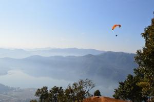 Tandem paragliding above Phokara Lake